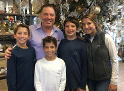 Mark Silacci, posing with family in the shop