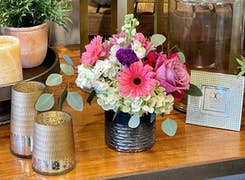 A bouquet of pink, purple and white flower on display in our Salinas showroom